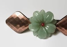 Jade Barrette Large French Barrette Upcycled Hair Barrette French Clip Green Barrette Vintage Jewelry Hair Clip Hair Slide Hair Accessories I love this piece. This unique handmade barrette is on a 3 inch french clip barrette. Hand crafted from vintage earrings. Jade Green flower with copper colored ends. Recycled one of a kind jewelry. Made in the USA. I am reworking my store to improve exposure. I have had my store for several years an...