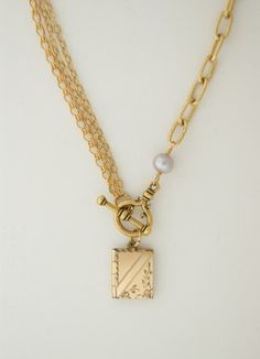 Gold chain link necklace with freshwater pearl and antique locket