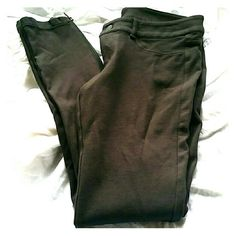 Express Charcoal Grey Legging Pants Excellent condition without any flaws. 68% rayon, 27% nylon, & 5% spandex. Zippers on outer side of legs that goes to about the knee. Zipper with button on front and 2 back pockets. Soft and stretchy! Express Pants Leggings