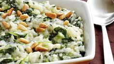 Bake this creamy risotto featuring rice, Progresso® chicken broth and frozen spinach – a cheesy Italian side dish.