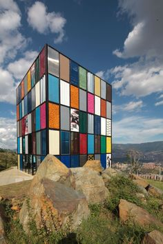 Disconnected Pavilion in Medellin by Plan B Arquitectos. The facade is comprised of donated removable panels which can be adjusted for the climatic conditions. Colourful Buildings, Unique Buildings, Amazing Buildings, Office Buildings, Colour Architecture, Facade Architecture, Amazing Architecture, Chinese Architecture, Futuristic Architecture
