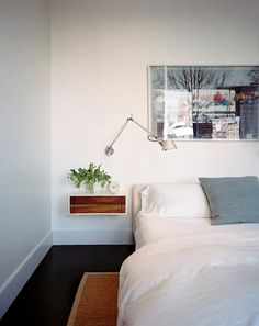 Bedroom White Photo - White bedding and a swing-arm sconce above a bedside table