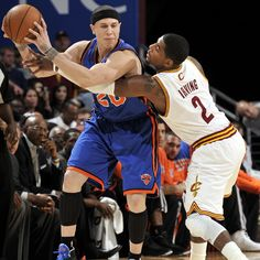 The Knicks' Mike Bibby tries to shake free of the Cavs' Kyrie Irving during the first half