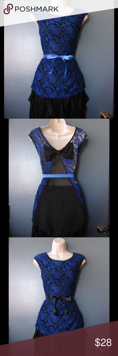Divine Black/Blue Peplum Lace Top W/Bow & 2 Belts NWOT. This Blouse is really cute and beautiful. Soft and comfy. Stretchy material. Big bow and mesh detail. Belts included. Size Large 12 - 13 Save $$$ on bundles. Tops Blouses