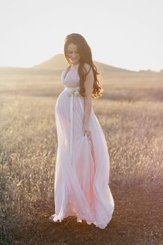 pale, pale pink. gold ribbons.... love this dress for a future mommy to be session!