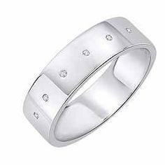 Obrączka Ślubna z diamentami Staviori Obrączka.  6 Diamentów, szlif brylantowy, masa 0,02 ct., barwa H, czystość SI2.  Białe Złoto 0,585. Szerokość 5,5 mm. Grubość 1,2 mm.  Dostępne inne kolory złota.