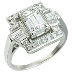 Art Deco 1.37 Carat Emerald Cut Diamond Platinum Ring | From a unique collection of vintage engagement rings at https://www.1stdibs.com/jewelry/rings/engagement-rings/