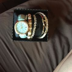 Watch and four bracelets Never used still has the tag no damage Accessories Watches