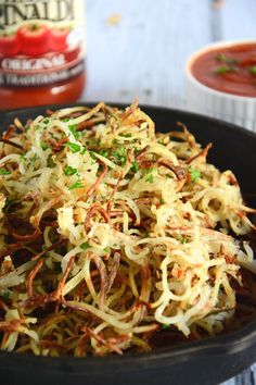 Crispy Garlic Curly Fries | The Housewife in Training FIles - requires a julienne peeler or spiralizer.
