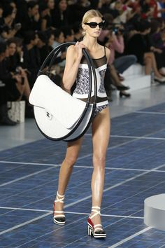 Chanel hoola hoop bag. We love Chanel, and would actually love to see someone rocking this, but it is a little crazy!