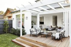 Lovely extension of the living space to the outdoor space with deck and pergola. Beach Bungalow Exterior, Outdoor Deck Decorating, Weatherboard House, Cottage Renovation, Beach Bungalows, Facade House, Cottage Homes, Cottage Style, Home Reno