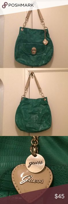Large Turquoise Guess Purse Large Turquoise Guess Purse. The top around the opening of the purse is a little worn, but is still in great condition. Guess Bags Shoulder Bags