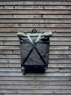 This backpack was made with chocolate brown waxed filter twill in combined with a olive green waxed canvas roll to close top I made it into an