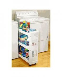 Rolling laundry organizer - available at Lowe's. Love this idea of easy roll out shelf in middle.