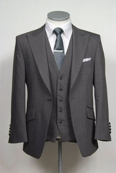 """grooms wedding suit in grey slim fit light weight wool with classic waistcoat. Mens sizes from 32"""" chest upward and include extra short, short, regular, long and extra long fittings. Boys sizes from 20"""" to 34"""" chest. Complete outfit includes jacket, skinny trousers, hire or matching waistcoat, brand new traditional or French wing slim fit shirt in white or ivory, tie or cravat, braces and cufflinks. £150.00 to hire #groom #wedding #suit #hire #suithire #waistcoat #grey"""