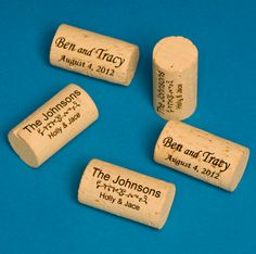 custom laser engraved wine corks!!  great as wedding favors from PersonalizedWedding.com