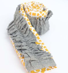 @Ashley Green, how much will you charge me to make a new and cute camera strap cover?  Maybe a royal blue and white in place of the yellow and white.  Might work well with old shirt scraps.