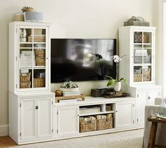 Logan Medium Media Suite | Pottery Barn the Ikea borgos is similar but not in price.  I love the styling here