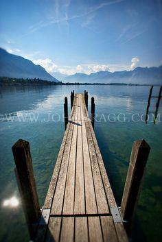 Photo of a pier overlooking scenic Lake Geneva in Montreux, Switzerland