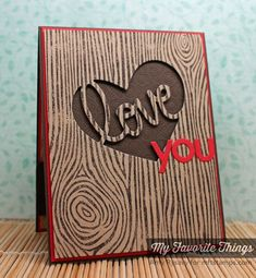 ;handmade Valentine card: Love You by AmyR ... stamped wood grain ... brown on kraft ... negative space heart with LOVE left in ... brown base card textured with xo's ... punch of red in die cut YOU and panel layering ... My Favorite Things ...