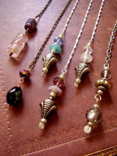 Pendulum Divination. Maybe we can make pendulums and practice at the party, or I can just bring mine and we can try it out.