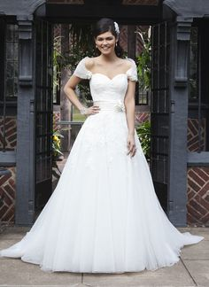 Sincerity wedding dress style 3724 This style is a circular cut tulle ballgown with a corded lace  sweetheart neckline and a detachable caplet. Hand rolled flowers accent  the caplet and the regal satin cummerbund. The gown has a chapel length  train and buttons to the bottom of cummerbund.