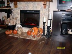 More pumpkins in front of the fireplace