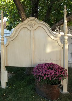 Queen headboard painted in Annie Sloan Old Ochre, Old White and washed in French Linen chalk paint. Lots of dark and gold gilding wax and pearl plaster.