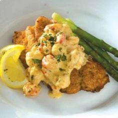 Check out this Kingfish Red Fish recipe topped with lump crab meat from LouisianaSeafood.com #recipes #crab #seafood