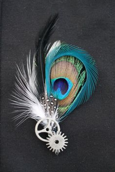 Men's Boutonniere - All Steamed Up--i would not include the steam punk part of it, but i like the combo of feathers.