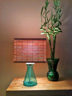A glass ikea beaker vase into a lamp