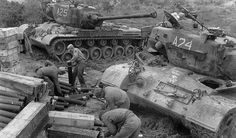 USMC tankers break open ammunition crates as they rearm their M46 Pattons at Panmunjom, on April 25, 1952.
