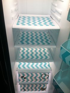 Makeover your refrigerator with cute drawer liners. keeps shelves clean too!!