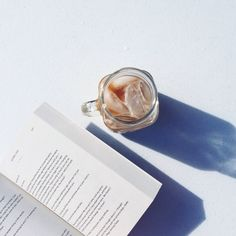 """bookbaristas: """"Ending #BookBaristasBirthday with an iced coffee and a good read! Check out the new blog here! """""""