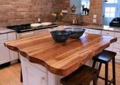 Reclaimed Longleaf Pine island top with Faux Wane Edges and a Waterlox Semi-gloss finish.