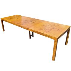 Mid-Century Modern Burl Wood Directional Dining Table | From a unique collection of antique and modern dining room tables at http://www.1stdibs.com/furniture/tables/dining-room-tables/