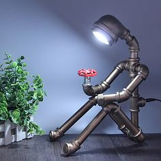 Retro Industrial Wind Desk Light Iron Pipe Table Lamp For Study Room / Office / Indoor Metal Table Lanterns, Table Lamps, Desk Lamp, Retro Industrial, Industrial Lamps, Industrial Furniture, Humanoid Robot, Pipe Lighting, Lighting Store