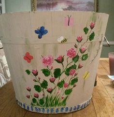 Diy plant pot fun complete with family finger print butterflies. Fun with the family.