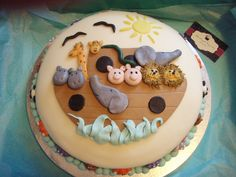 - This Noahs Ark Cake is made of marble flavor covered in butter cream fondant. The animals too were also made from fondant =)