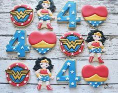 Wonder Woman Inspired Cookies, Wonder Woman Party Favors, Superhero Cookies, Girls Birthday Party, WW Cookies, DC Comic Inspired Cookies by Bakinginheels on Etsy https://www.etsy.com/listing/508894788/wonder-woman-inspired-cookies-wonder