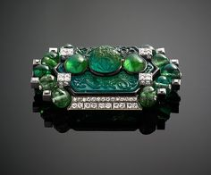 Brooch with Carved Emeralds and Diamonds by Cartier Cartier (French, founded Paris, 1847)