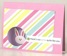 "Diagonally striped paper gives this simple Easter card an extra burst of energy. Melissa punched a circle through her card's front flap to create an opening for her bunny accent to peek through. To complete the look, she topped the card with a green brad and an adorable printed sentiment, ""There's nobunny quite like you."""