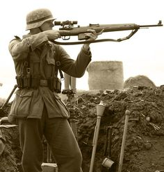 German sniper deploys the Gewehr 43 semi automatic rifle.