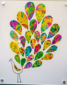 """Each kid could paint a large paper with bright colors then cut the """"feathers"""" and create their own peacock"""