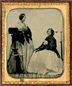 A daguerreotypist and her subject in 1850s New York.