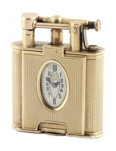 *A RARE 9CT GOLD DUNHILL UNIQUE WATCH LIGHTER CIRCA 1920'S Engine turned case, signed Dunhill Unique Lighter, Pat No 143752, AD, 9ct hallmarks, flip top arm, striker mechanism. Case measures 53mm/42mm/13mm, Oval watch movement with 15 jewels, housed in an oval hinged case.