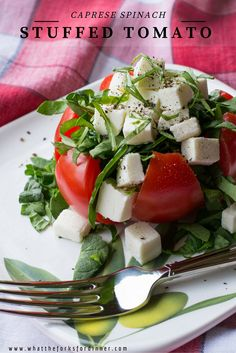 Caprese Spinach Stuffed Tomato - Spinach stuffed into a vine ripened tomato, topped with fresh mozzarella cheese and a basil pesto dressing.