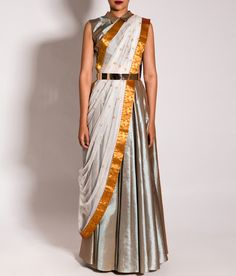 This ensemble features a gorgeous upada silk floor length pleated skirt  paired with a matching collared cropped choli. The ensemble is completed with a white net dupatta embellished with gold zardozi butis and a gold kanjivaram border.
