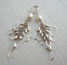 AA Grade Fresh Water Pearls at the top followed by a cascade of handmade 'little wings'