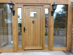 One of the Traditional Arched Oak Door With Sidelights made by TimberMaster LTD in UK Wooden Front Door Design, Wooden Front Doors, Oak Doors, Bespoke Furniture, Furniture Design, Double Front Doors, Joinery, Windows And Doors, Tall Cabinet Storage